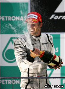 Jenson Button celebrates winning the Malaysian Grand Prix