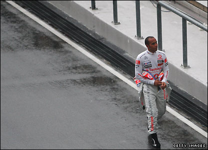 Lewis Hamilton trudges back to his McLaren garage in Malaysia