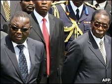 Morgan Tsvangirai (left) and Robert Mugabe, March 2009