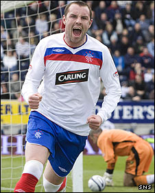 Kris Boyd celebrates his early goal at Falkirk