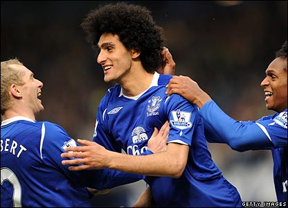 Marouane Fellaini is congratulated after scoring for Everton