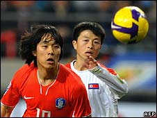 South Korea's Park Chu-Young (L) and North Korea's Mun In-Guk (1 April)