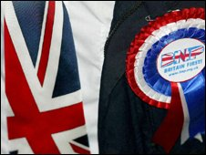 Rosette and Union flag tie both worn by British National Party member