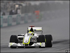 Jenson Button on his way to victory in the storm-hit Malaysian Grand Prix
