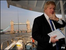London Mayor Boris Johnson rides aboard a Thames Clipper from Tower Bridge to Greenwich