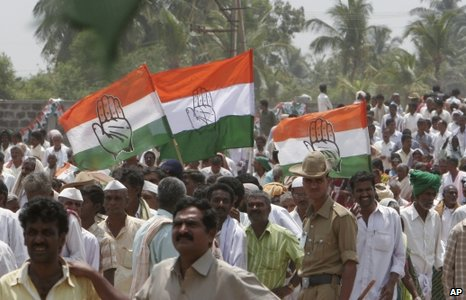 Congress party supporters hold flags with the election symbol of their party during an election campaign rally in Davangere, about 270 kilometers (167 miles) north of Bangalore, India, Monday, March 23, 2009.