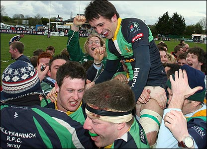 David Harris celebrates with his Ballynahinch team-mates after they had beaten Cork Constitution