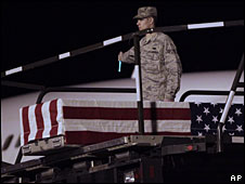 The coffin  of Air Force Staff Sgt Phillip Myers is lowered onto the tarmac at Dover Air Force Base, Delaware, 5 April 2009
