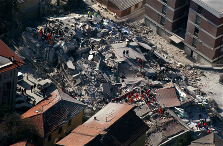 aerial photo provided by the Italian Police shows the debris of a collapsed building in an area near L'Aquila, central Italy,