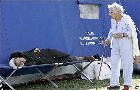 Two elderly women recover at a tent city set up after the earthquake in central Italy on 7 April, 2009.