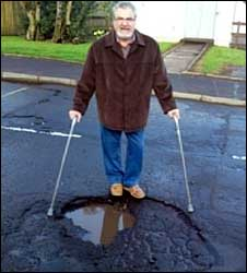 Andy Benny by a pothole