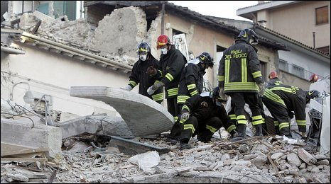 Firefighters continue to search rubble in L'Aquila for survivors more than 24 hours after a quake struck central Italy.