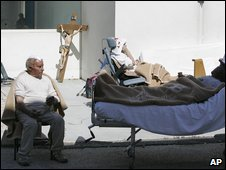 Patients being treated outside the San Salvatore hospital in L�Aquila, 6 April 2009