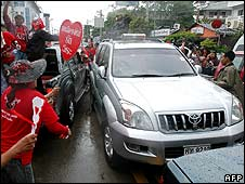 Protesters chase the vehicle of the Thai prime minister in Pattaya