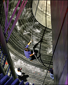 Workers placing a hi-res cable