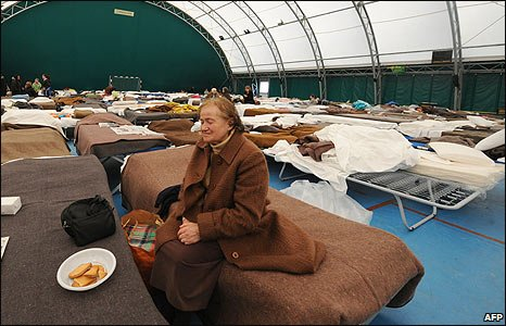 An elderly woman in a temporary shelter in a sports centre in L'Aquila, Italy