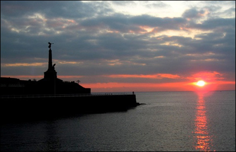 A lovely shot of the war memorial in Aberystwyth silhouetted at sunset (Phil Wells).