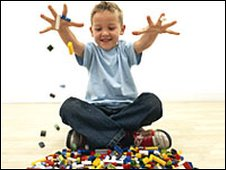 Child playing Lego