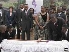 President Paul Kagame and First Lady Jeanette Kagame � look on as attendants place a symbolic coffin in a mass-burial site in Nyanza, near Kigali, Rwanda, on 7 April 2009