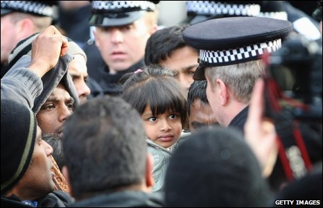 A girl becomes the focus of a rally in London against alleged human rights abuses in Sri Lanka