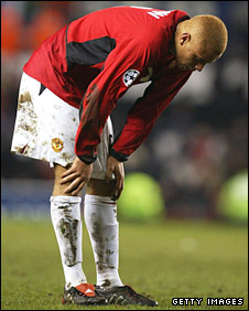 Wes Brown is left dejected after the final whistle at Old Trafford