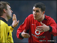 John O'Shea argues with referee Valentin Ivaov after Roy Keane's first-leg red card