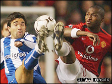Djemba-Djemba and Deco battle for the ball