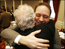 Vermont State Representative Jason Lorber (R) hugs Stan Baker following the passage of a gay marriage bill in the state, 7 April , 2009