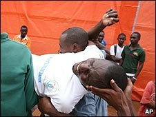 A man is carried out of the stadium in Kigali, Rwanda (07/04/2009)