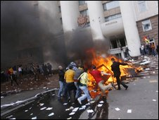 Demonstrators set a bonfire on the steps of parliament, 7 April in Chisinau