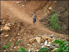 Child on dirt path