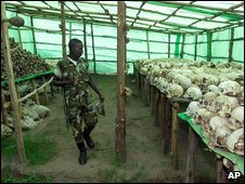 A Rwandan soldier looks at the hundreds of human skulls and remains of genocide victims in Bisesero, Rwanda