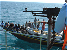 Yemeni coastguard check out a fishing vessel