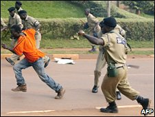 A Ugandan man runs away from police in Kampala in November 2007 during the Commonwealth Heads of Government Meeting in the capital