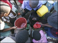 children collecting water in Zimbabwe