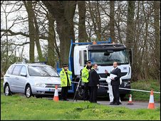 Police officers at a cordon close to where another body part was found