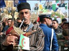 Musician plays his traditional Kabyle bagpipe as Algerian President Abdelaziz Bouteflika tours Tizi Ouzou, Algeria, on 27 March 2009