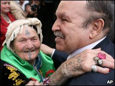 Algerian President Abdelaziz Bouteflika embraces a woman in Tizi Ouzou, Algeria on 27 March 2009