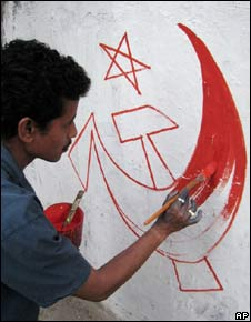 """A Communist Party of India Marxist party cadre paints his party""""s election symbol on a wall, ahead of Indian parliament""""s lower house elections, in Calcutta, India, Saturday, March 7, 2009."""