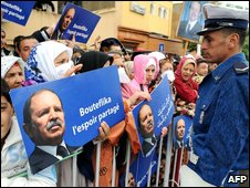 Algerian supporters display posters of President Abdelaziz Bouteflika during an election campaign rally in Algeria on 3 April 2009