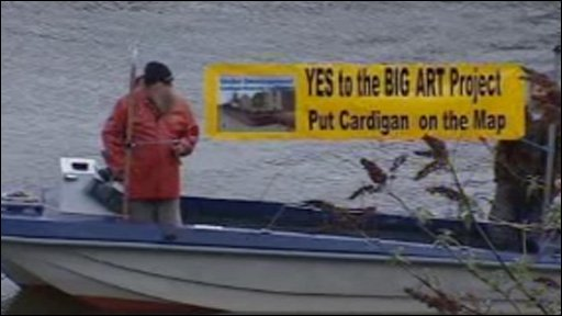 Banner on boat: Yes to Big Art Project; put Cardigan on the map