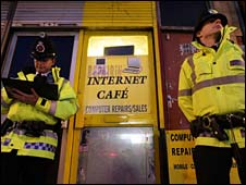 Police outside an internet cafe in Manchester