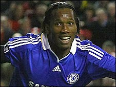 Didier Drogba wheels away in celebration after putting Chelsea 3-1 ahead at Liverpool