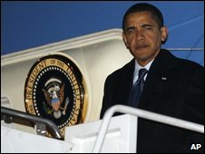 President Barack Obama steps off Air Force One as he arrives at Andrews Air Force Base
