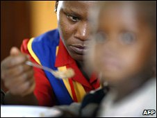 A nurse feeds a young Aids patient at a HIV/Aids clinic on the outskirts of Kampala in November 2007 