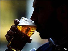 Man drinking pint