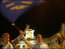 Filip Sikorski (in the middle) with his brother and a friend waving the EU flag after Poland voted in a referendum to join the European Union in 2003