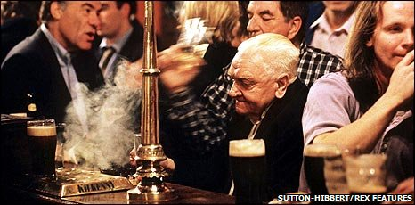 Man in a busy pub
