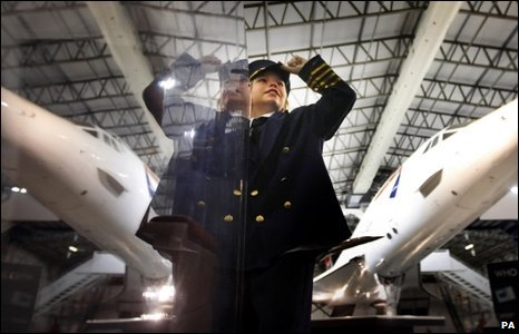 A visitor is pictured with Concorde at the National Museum of flight in Scotland.