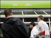 Men standing outside a job centre in Chatham, Kent